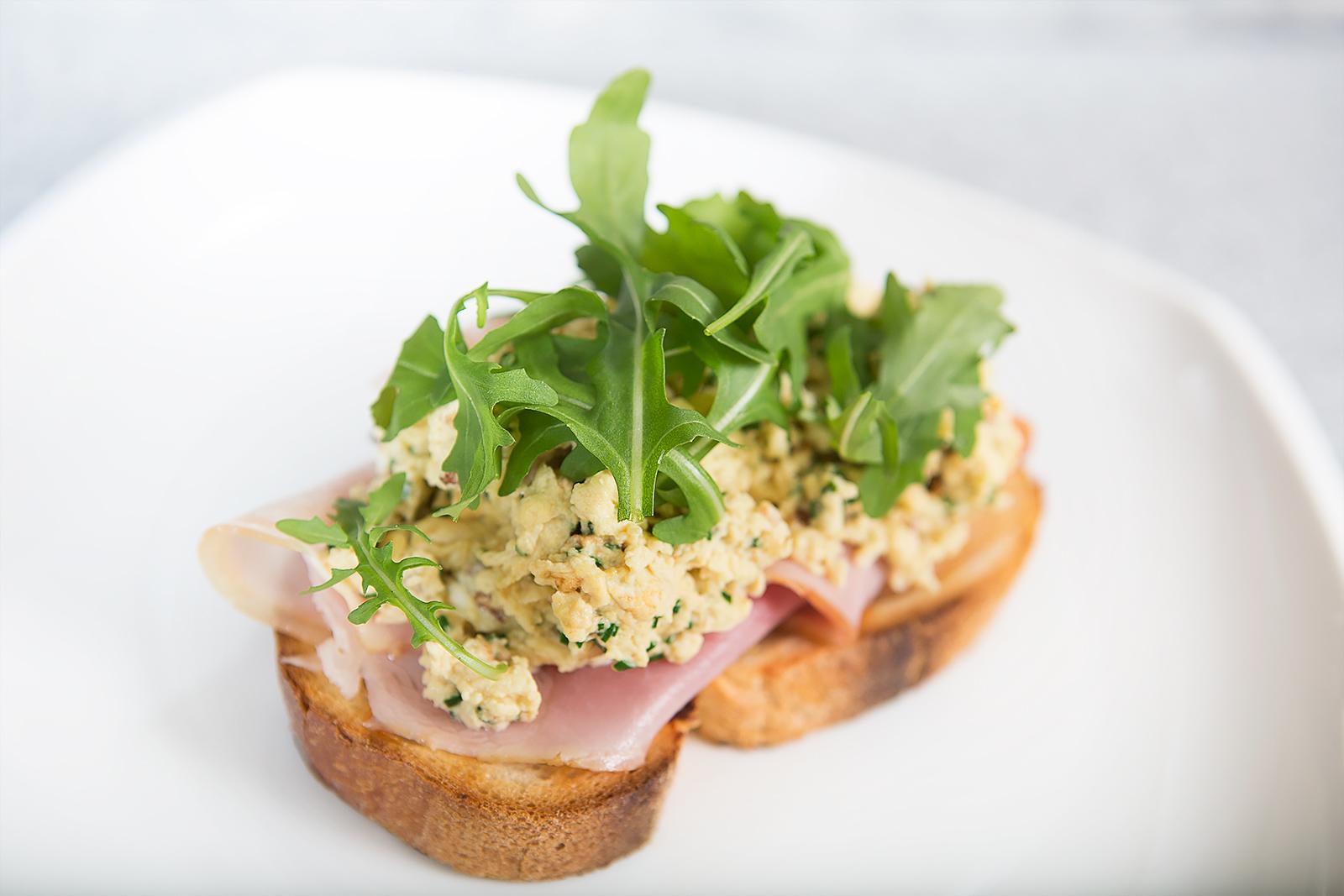 Brushetta with D'Orsogna Honey Ham off the bone and scrambled eggs