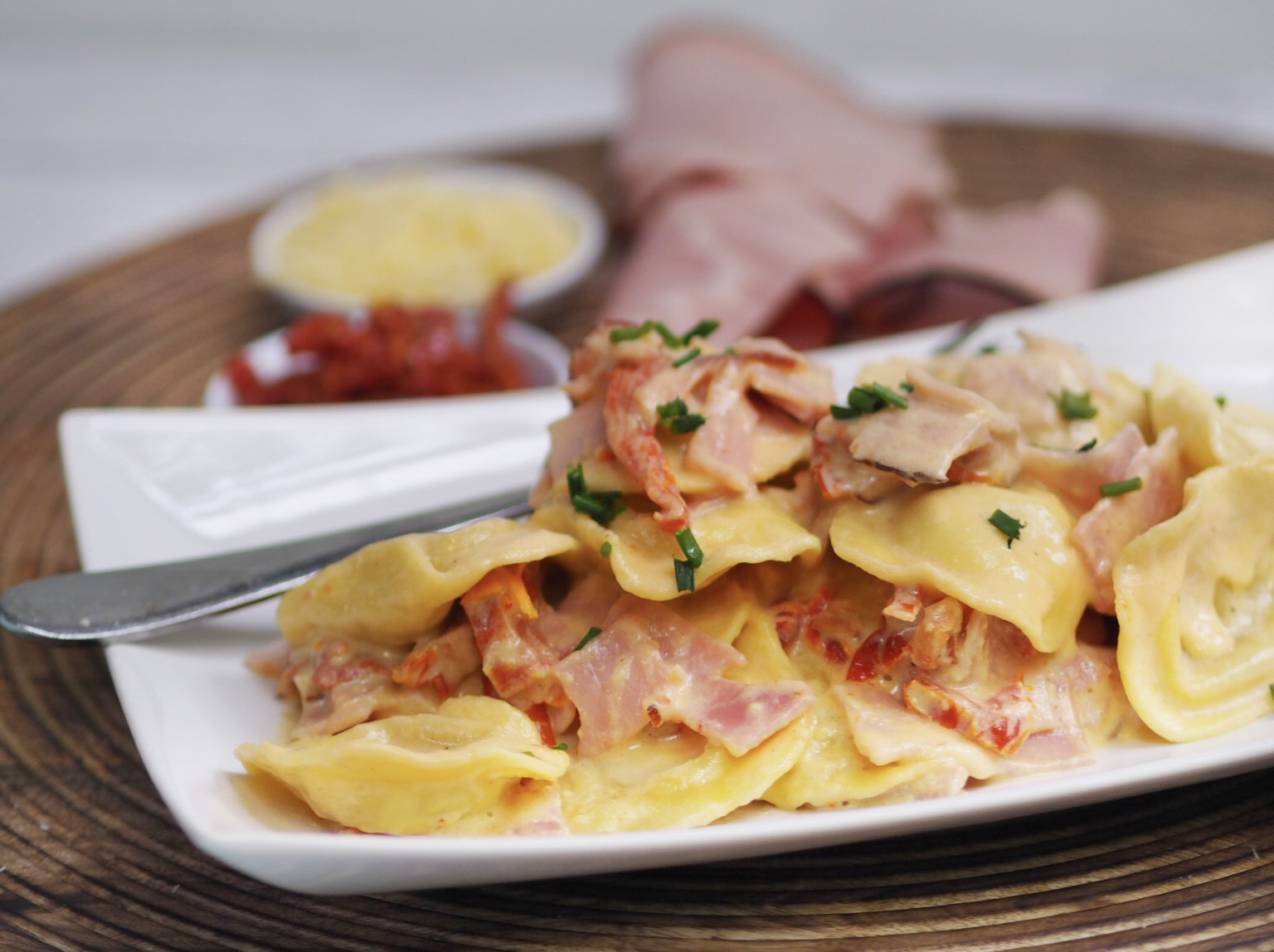 10 Minute Creamy Cheese Ravioli with Ham and Sun Dried Tomatoes